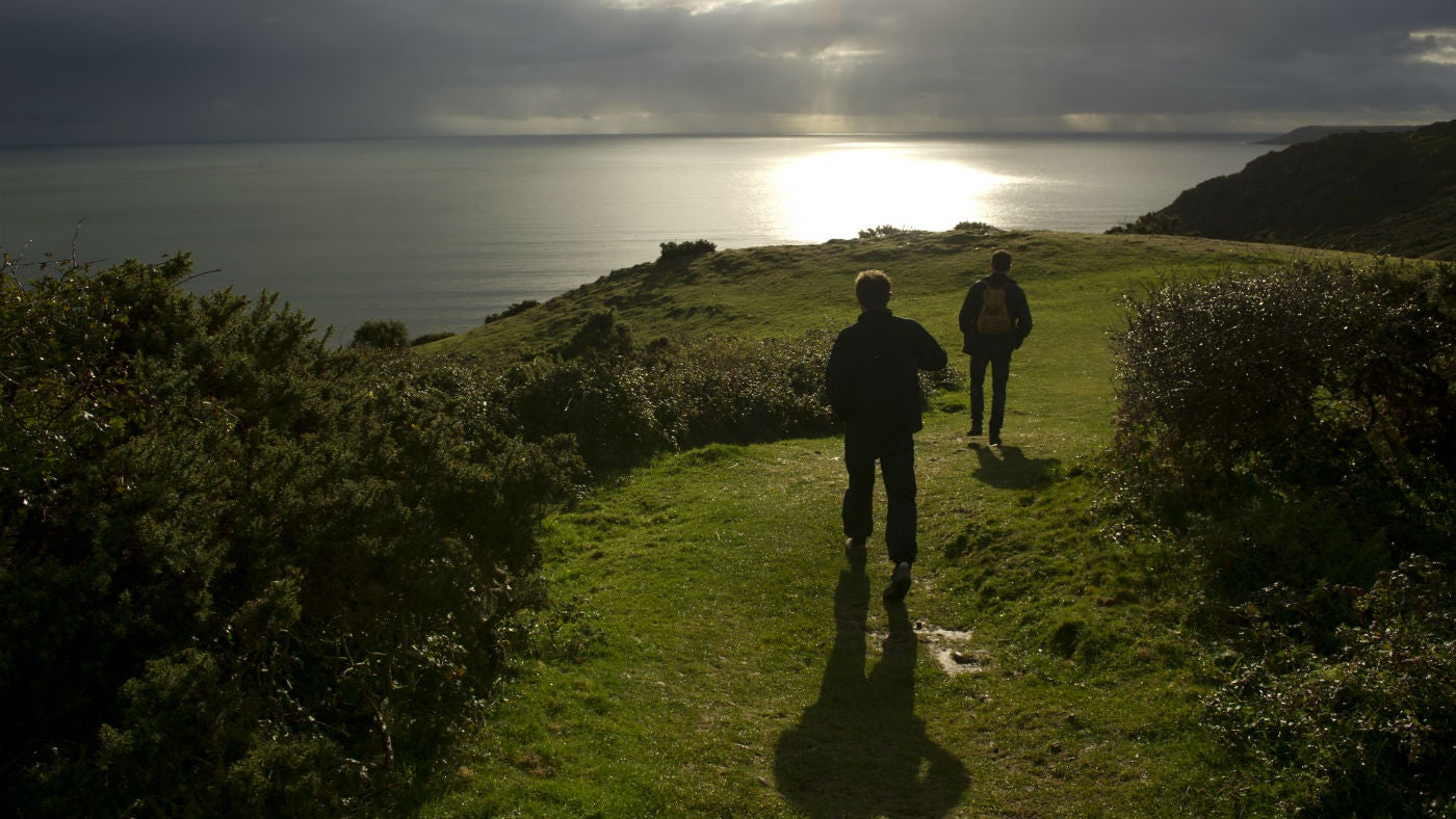 Visitors on Pennard Cliffs, Gower, Wales.