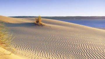 A view across a beautifully rippled sandy beach