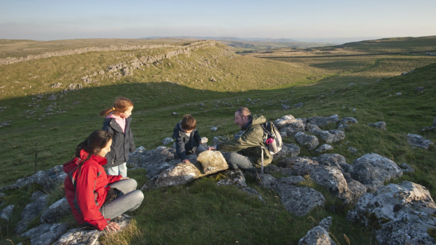 Family on a walk around Malham Moor in the Yorkshire Dales