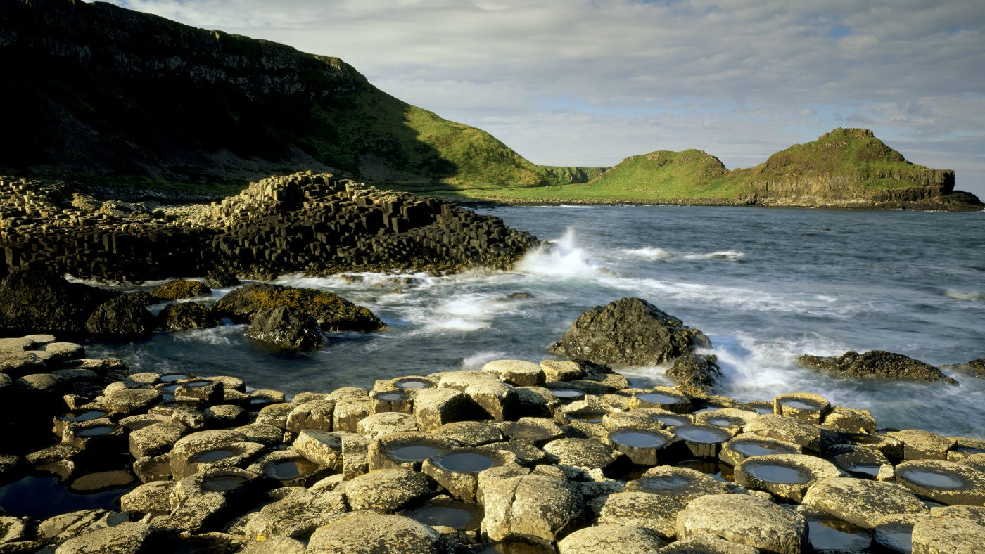 Waves crash against the Giant's Causeway, Co Antrim, Northern Ireland