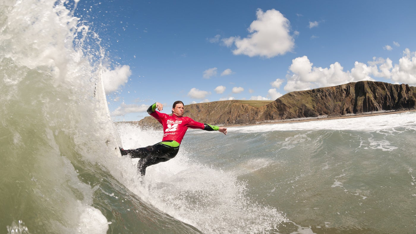 National Trust Surf Ambassador surfing at Sandy Mouth, Cornwall