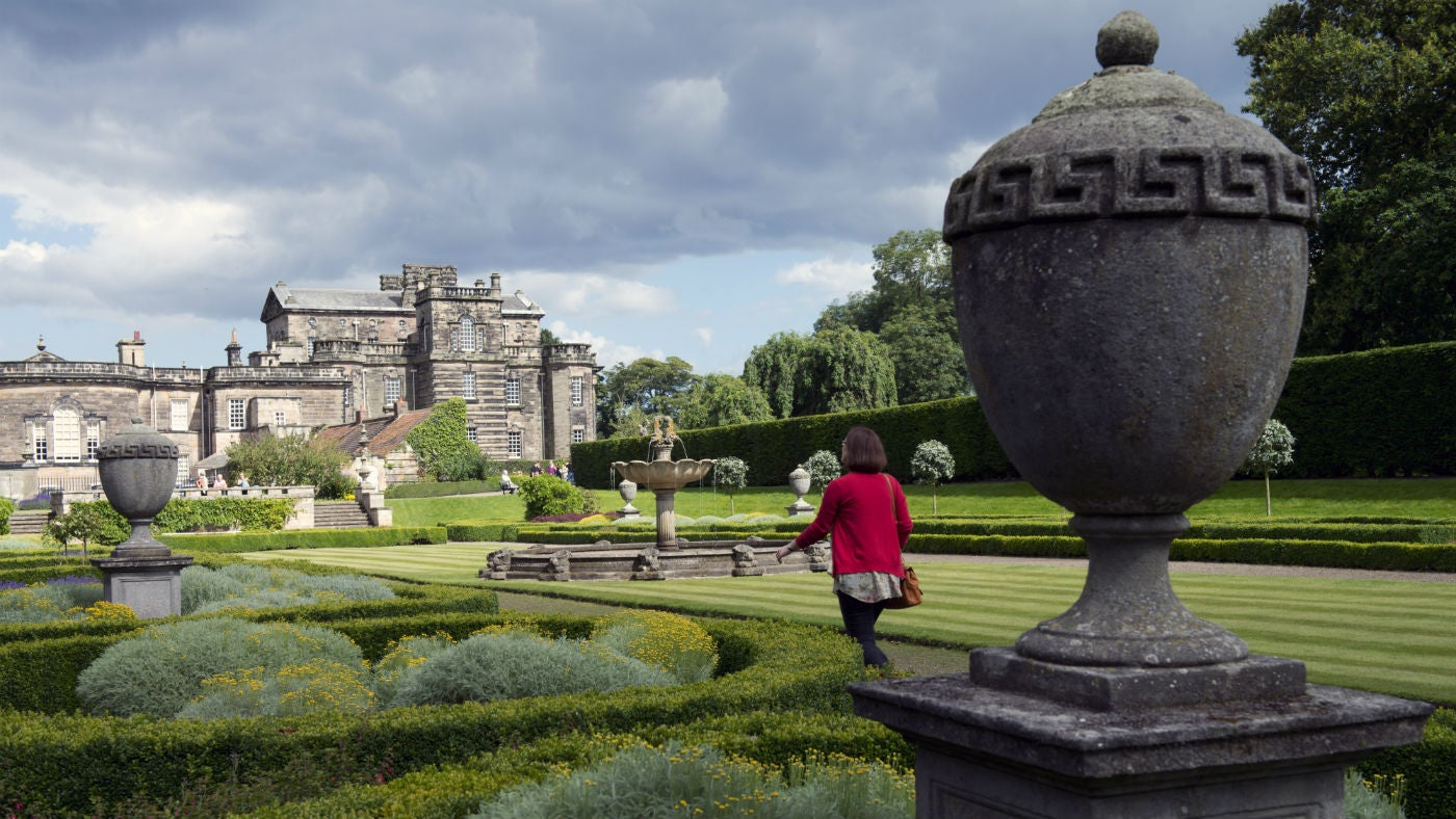 A lady enjoys a stroll through the gardens at Seaton Delaval