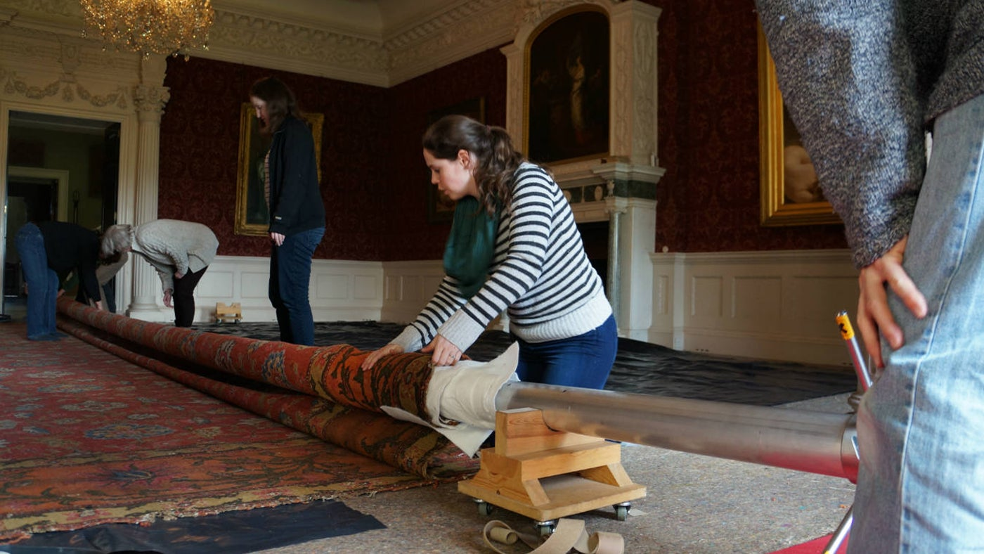 The carpet being removed for restoration