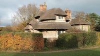 A round thatched cottage at Blaise Hamlet