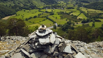 Cairn on Castle Crag overlooking Upper Borrowdale, Cumbria.