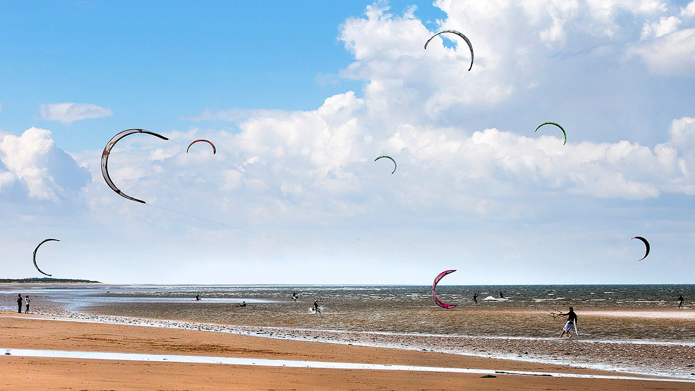 kite surfers on brancaster beach