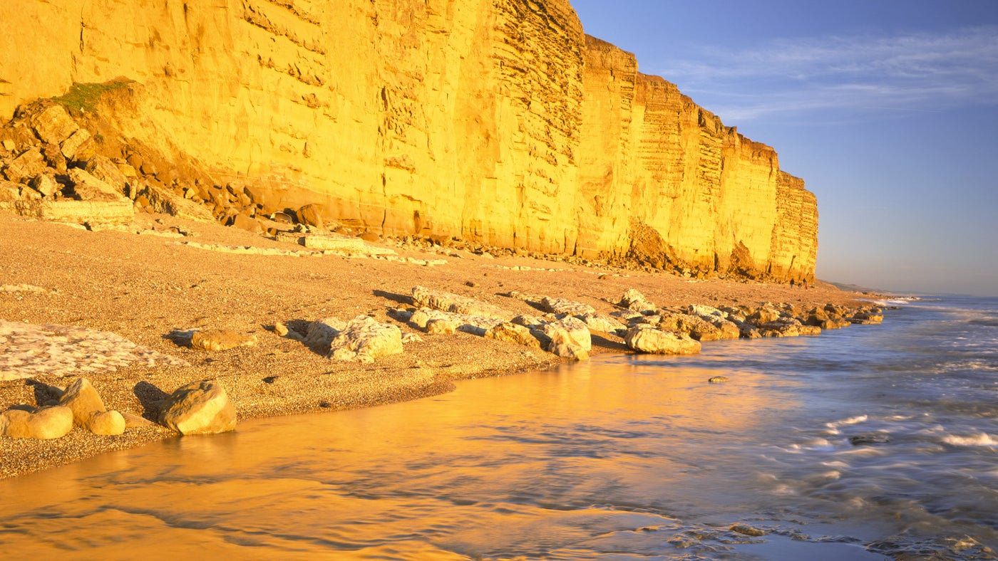 View of Burton Cliff and Beach in Dorset looking East, taken in late winter sunlight from the waters edge