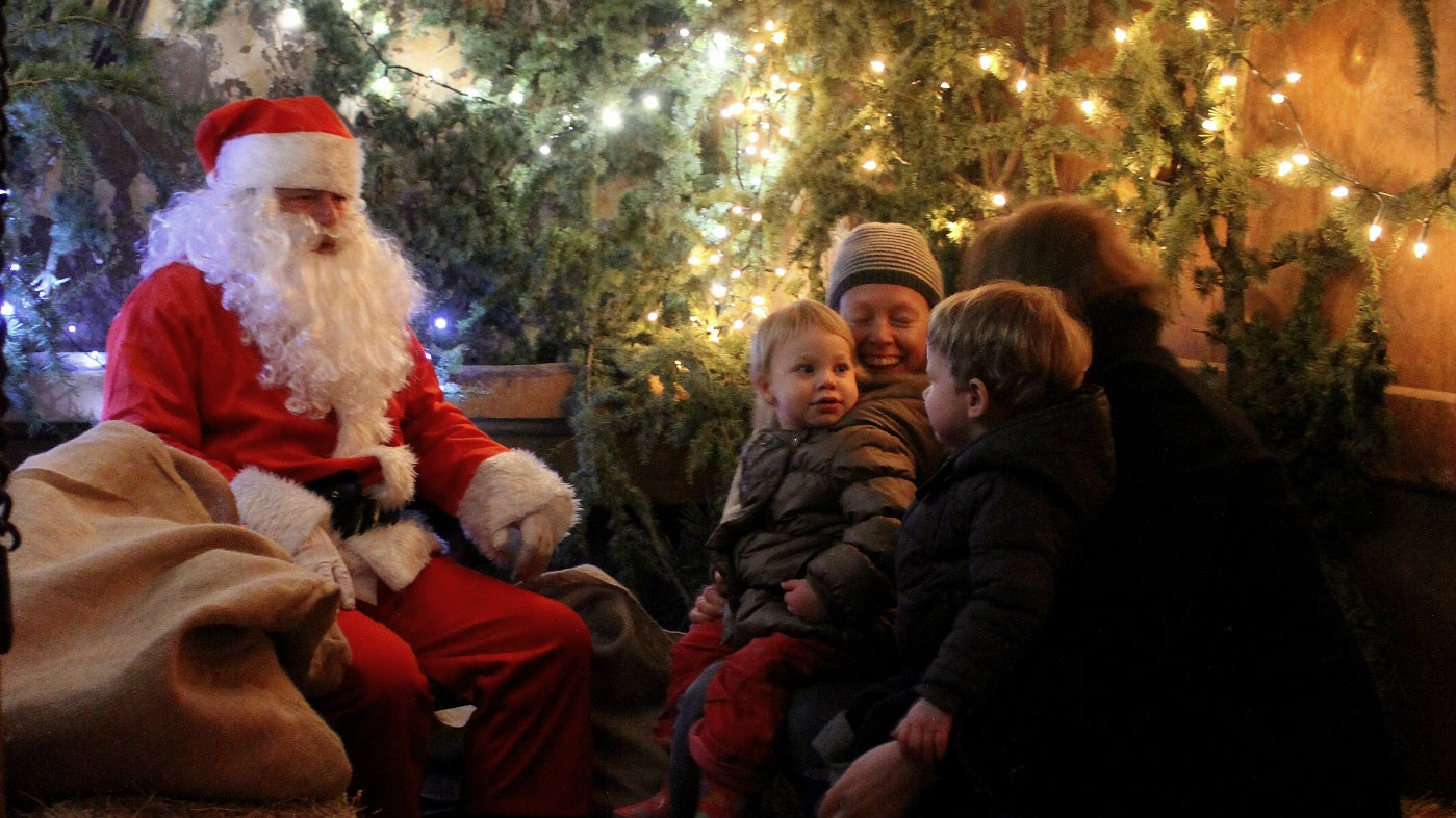 Children and parents meet Father Christmas at Calke Abbey
