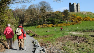 Couple walking on the Castle Trail with Audleys Castle in the background