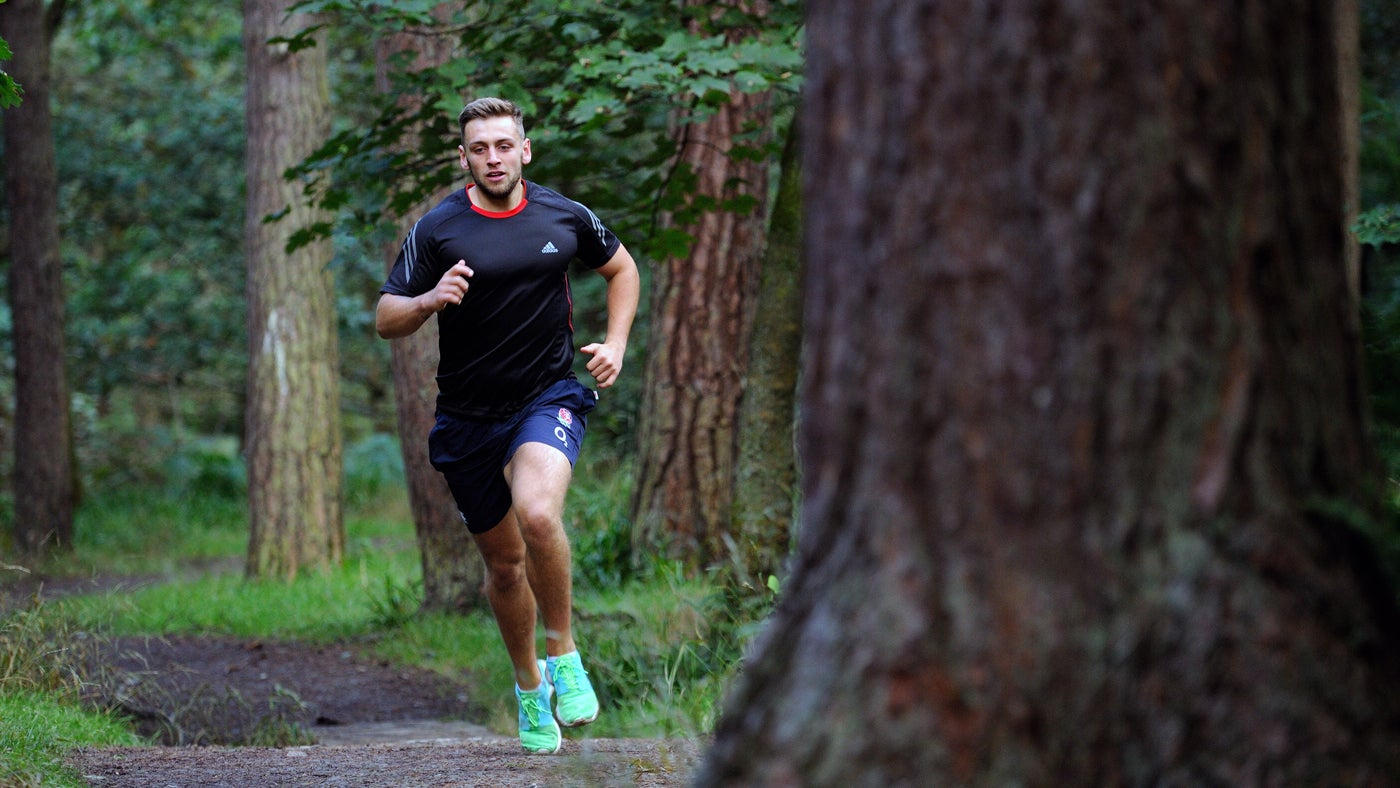 Visitor running in woodland