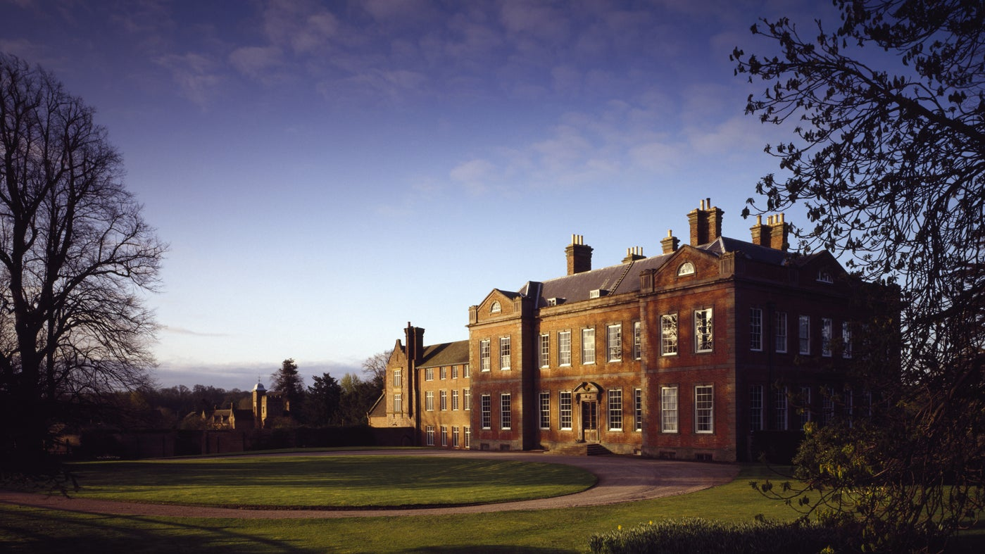Sunlight and shadows bathe the East Front of Dudmaston Hall as the evening sun sets