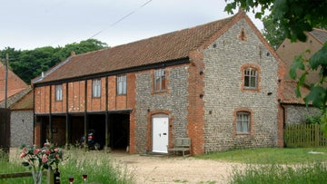 The exterior of Cart Lodge Barns on the edge of the Sheringham estate