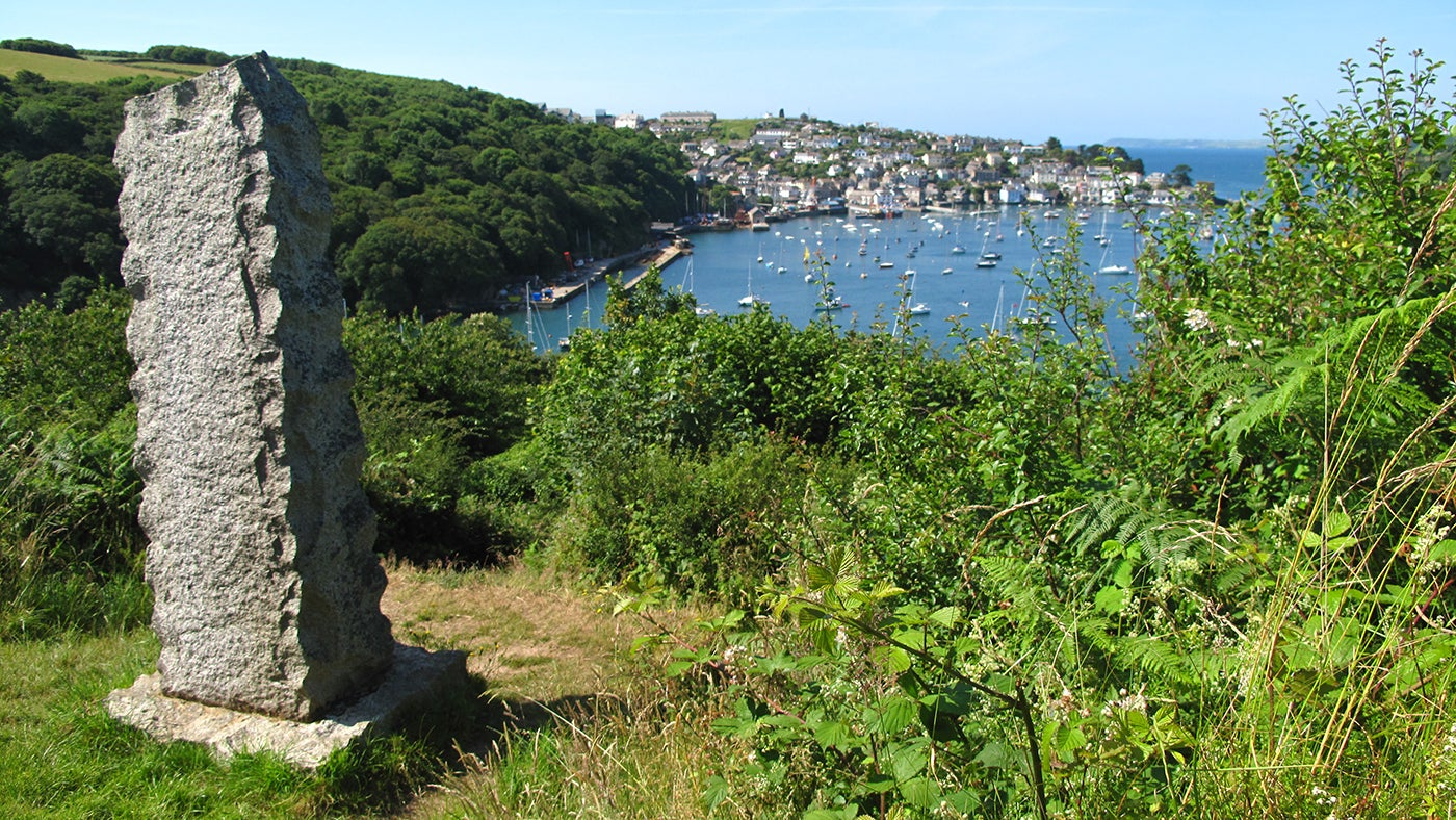 Looking at the Q Memorial on the eastern side of the Fowey Estuary