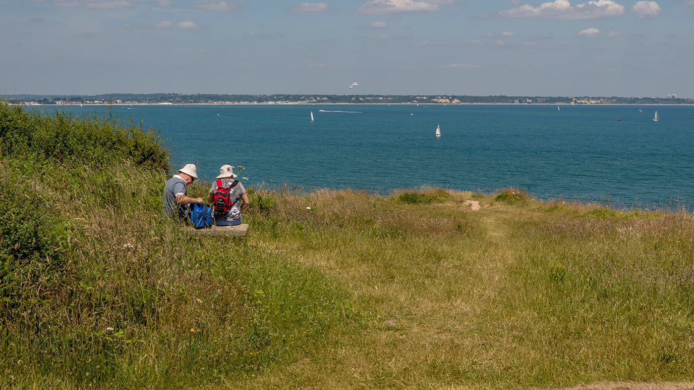 Walkers on the cliffs near Old Harry in Studland, Dorset