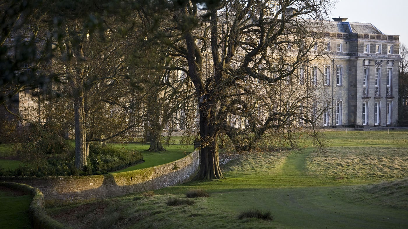The West front of Petworth House and the ha-ha in the grounds in November, West Sussex