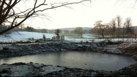 Pistol Pond in winter at Hare Hill in Cheshire