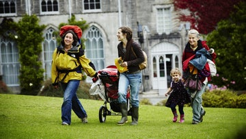 Family walking through Plas Newydd grounds