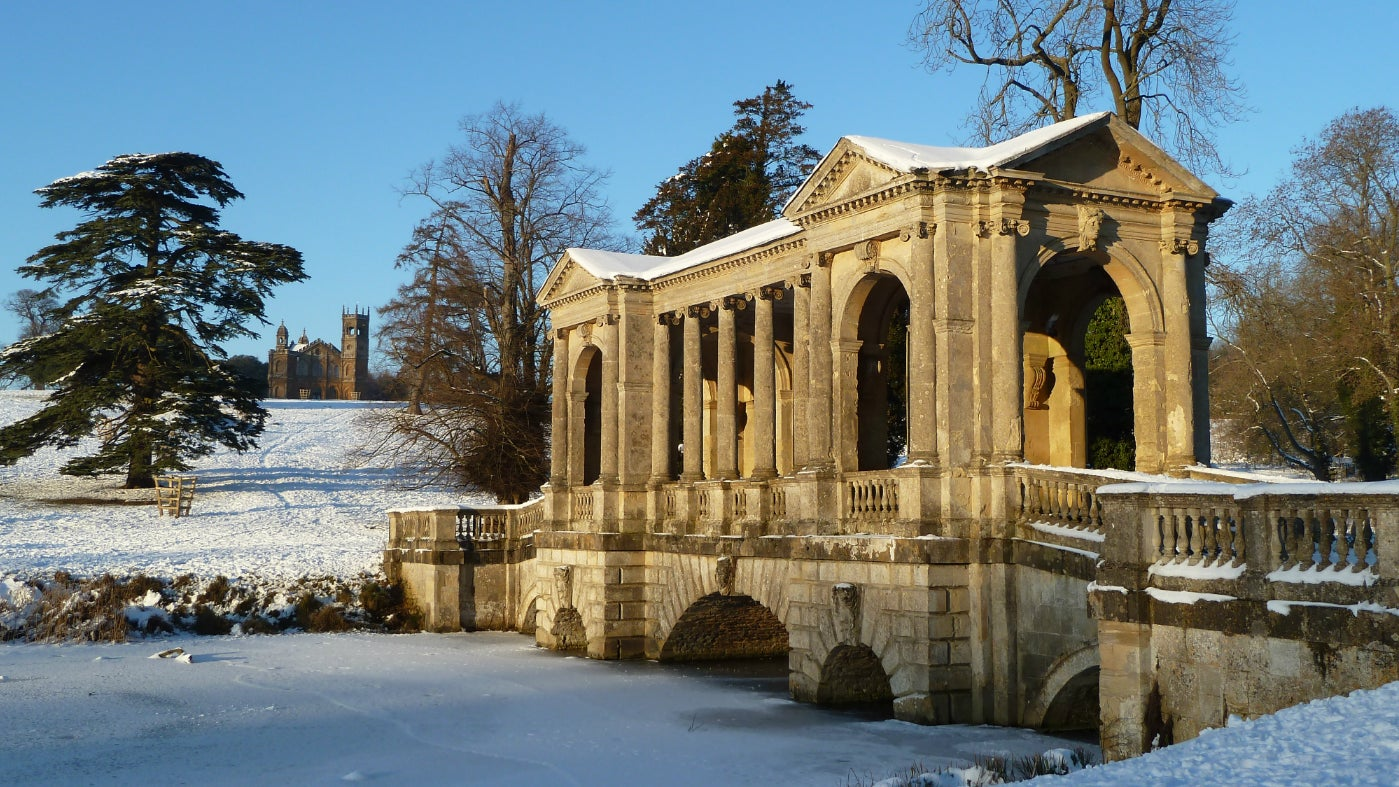 The Palladian Bridge at Stowe covered in snow.