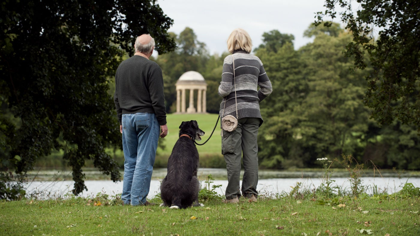 Walking the dog at Stowe Landscape Gardens in Buckinghamshire