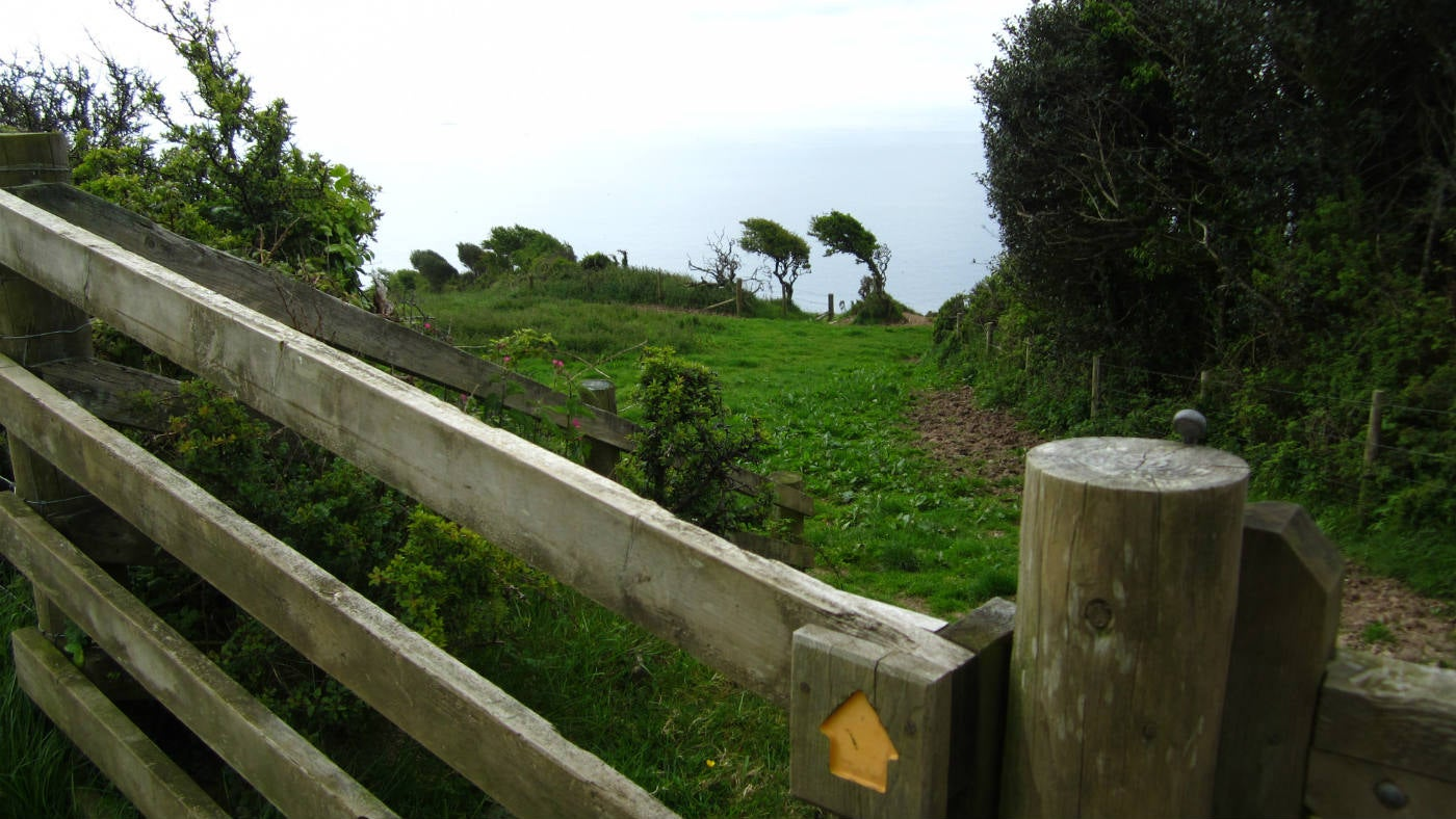 Looking over the gate and up the hill path with views over Looe Bay