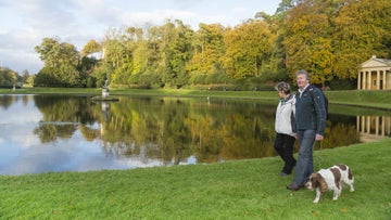 Couple walking by the moon ponds in Studley Royal water garden