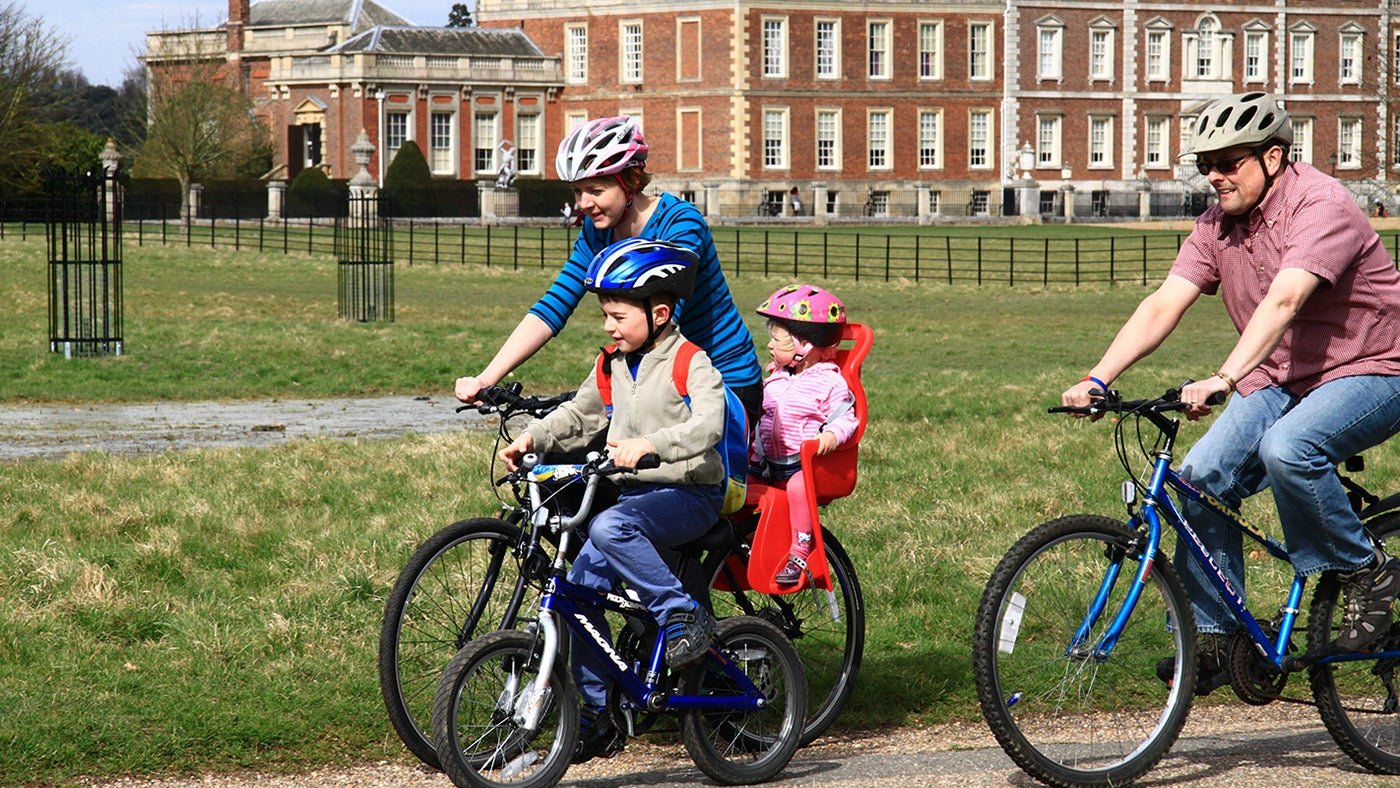 A family enjoying a cycle ride at Wimpole