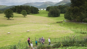 Family walking in Wray Castle grounds, Cumbria